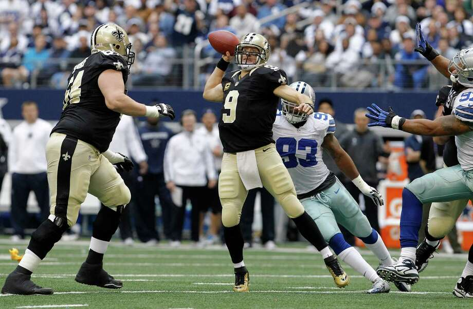 New Orleans Saints quarterback Drew Brees (9) passes the ball against the Dallas Cowboys during the first half of an NFL football game on Sunday, Dec. 23, 2012, in Arlington, Texas. (AP Photo/Brandon Wade) Photo: Brandon Wade, Associated Press / AP