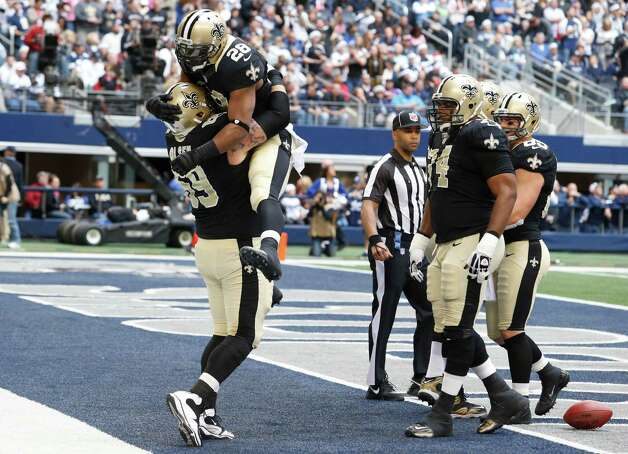 New Orleans Saints running back Mark Ingram (28) celebrates his touchdown with teammate Eric Olsen (69) during the first half of an NFL football game against the Dallas Cowboys  Sunday, Dec. 23, 2012 in Arlington, Texas. (AP Photo/Sharon Ellman) Photo: Sharon Ellman, Associated Press / AP