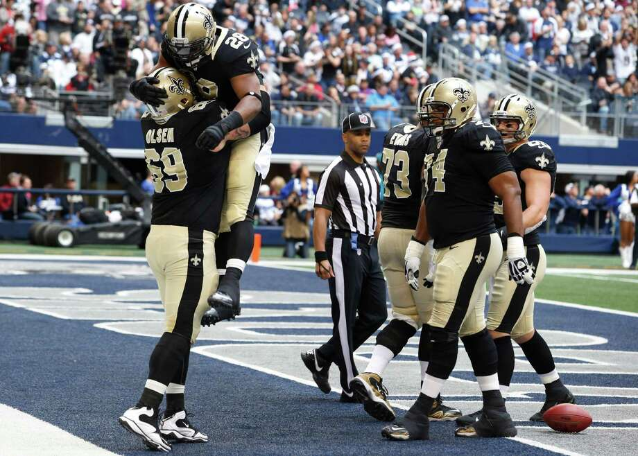New Orleans Saints running back Mark Ingram (28) celebrates his touchdown against the New Orleans Saints with Eric Olsen (69) as Jermon Bushrod (74) joins in during the first half of an NFL football game on Sunday, Dec. 23, 2012, in Arlington, Texas. (AP Photo/Sharon Ellman) Photo: Sharon Ellman, Associated Press / AP