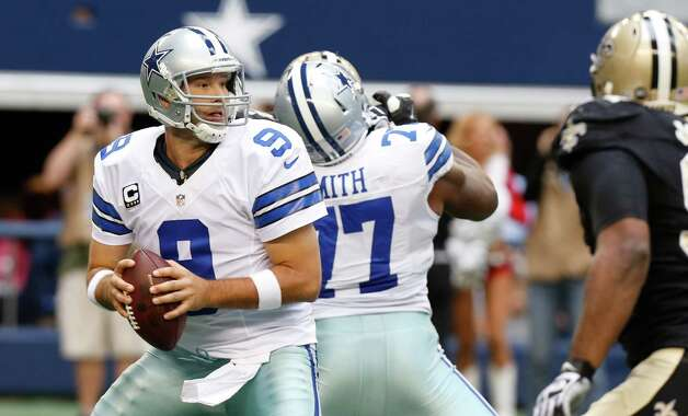 Dallas Cowboys quarterback Tony Romo (9) looks to pass during the second half of an NFL football game against the New Orleans Saints  Sunday, Dec. 23, 2012 in Arlington, Texas. (AP Photo/Sharon Ellman) Photo: Sharon Ellman, Associated Press / AP