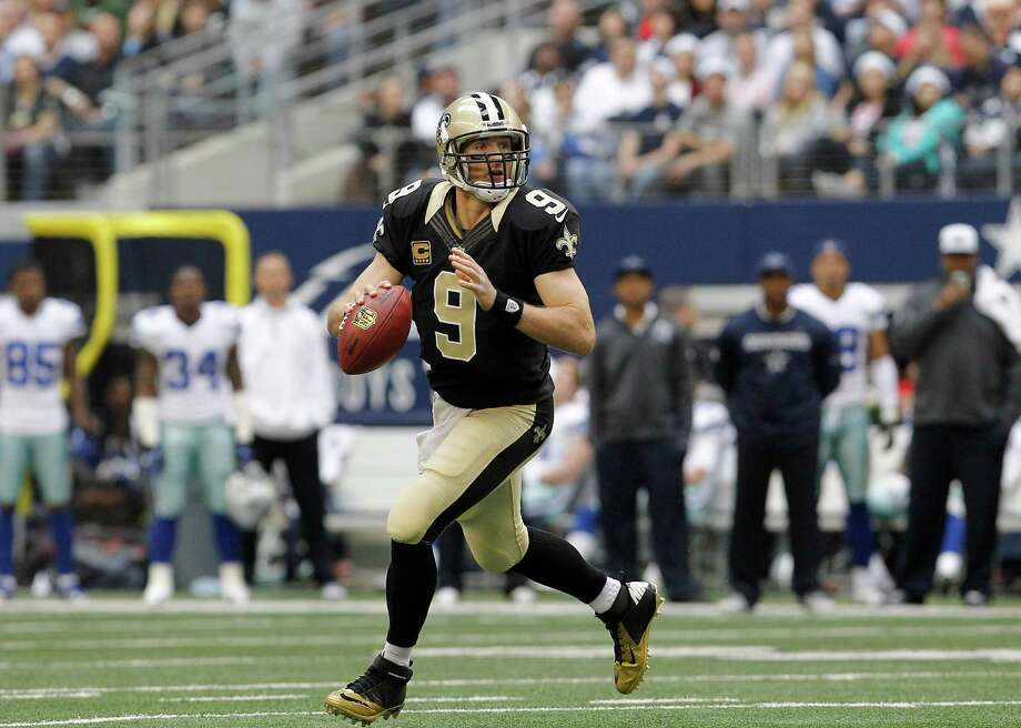 New Orleans Saints quarterback Drew Brees (9) rolls out to pas during the first half of an NFL football game against the Dallas Cowboys Sunday, Dec. 23, 2012 in Arlington, Texas. (AP Photo/Brandon Wade) Photo: Brandon Wade, Associated Press / AP