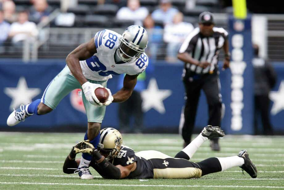 Dallas Cowboys wide receiver Dez Bryant (88) evades Dallas Cowboys cornerback Mike Jenkins (21) during the first half of an NFL football game Sunday, Dec. 23, 2012 in Arlington, Texas. (AP Photo/Sharon Ellman) Photo: Sharon Ellman, Associated Press / AP
