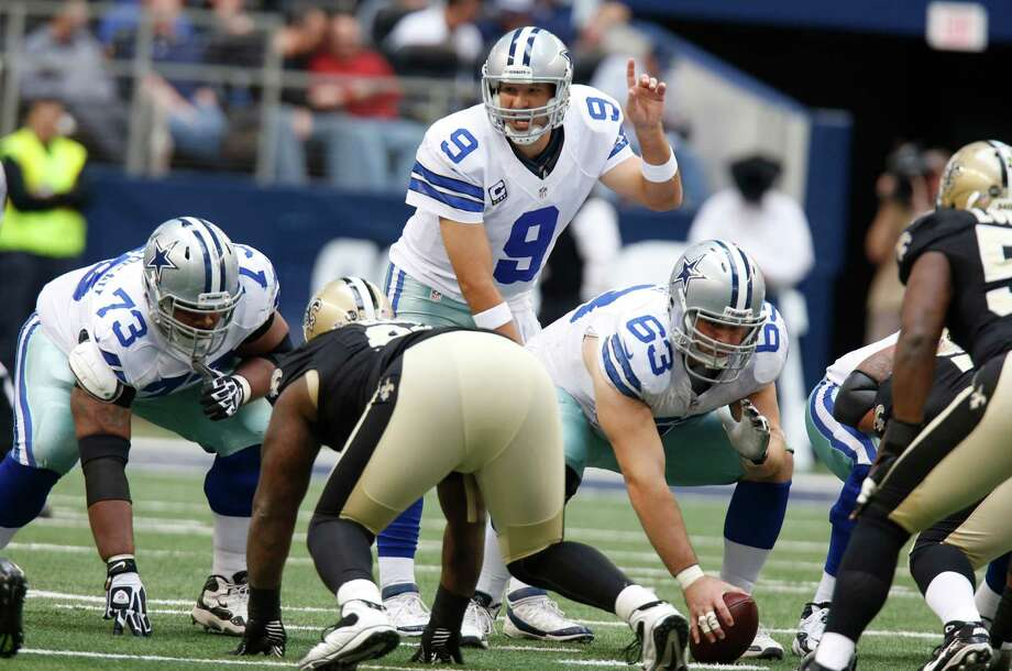 Dallas Cowboys quarterback Tony Romo (9) prepares to take the snap as teammates  Mackenzy Bernadeau (73) and Ryan Cook (63) line up during the second half of an NFL football game against the New Orleans Saints Sunday, Dec. 23, 2012 in Arlington, Texas. (AP Photo/Sharon Ellman) Photo: Sharon Ellman, Associated Press / AP