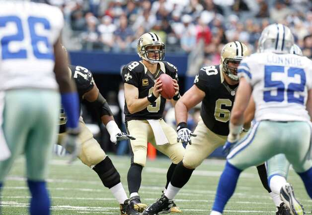 New Orleans Saints quarterback Drew Brees (9) takes the snap during the first half of an NFL football game against the Dallas Cowboys Sunday, Dec. 23, 2012 in Arlington, Texas. (AP Photo/Sharon Ellman) Photo: Sharon Ellman, Associated Press / AP