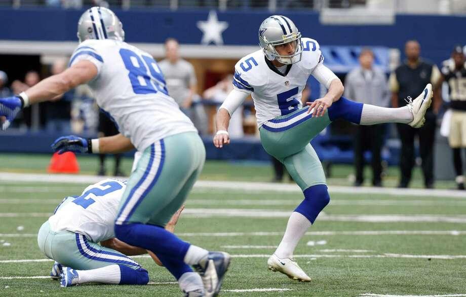Dallas Cowboys kicker Dan Bailey (5) attempts a field goal during the second half of an NFL football game against the New Orleans Saints Sunday, Dec. 23, 2012 in Arlington, Texas. (AP Photo/Sharon Ellman) Photo: Sharon Ellman, Associated Press / AP