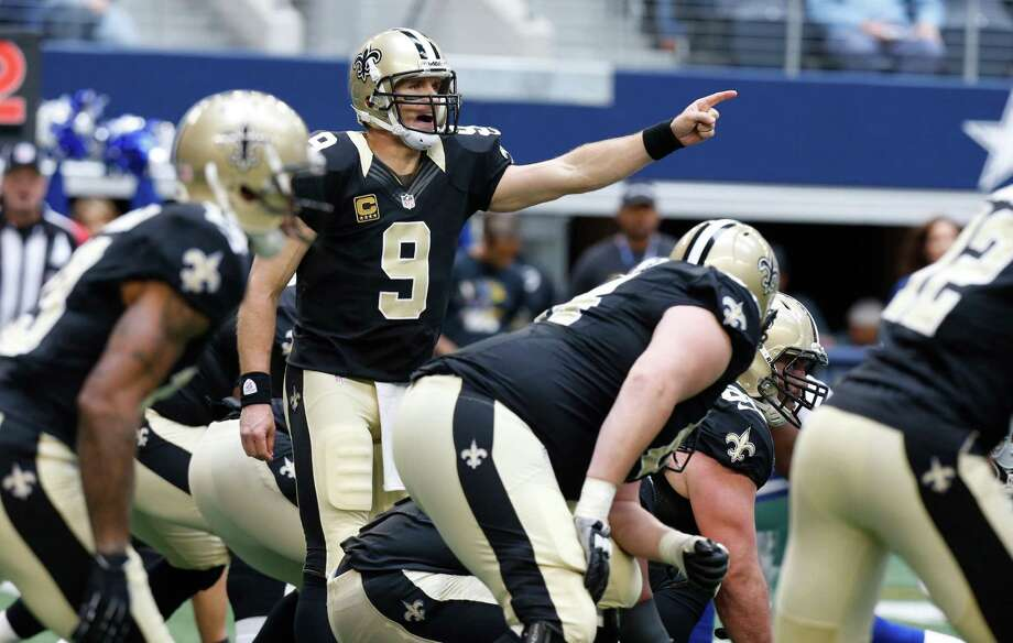 New Orleans Saints quarterback Drew Brees (9) calls a play from the line during the first half of an NFL football game against the Dallas Cowboys Sunday, Dec. 23, 2012 in Arlington, Texas. (AP Photo/Sharon Ellman) Photo: Sharon Ellman, Associated Press / AP
