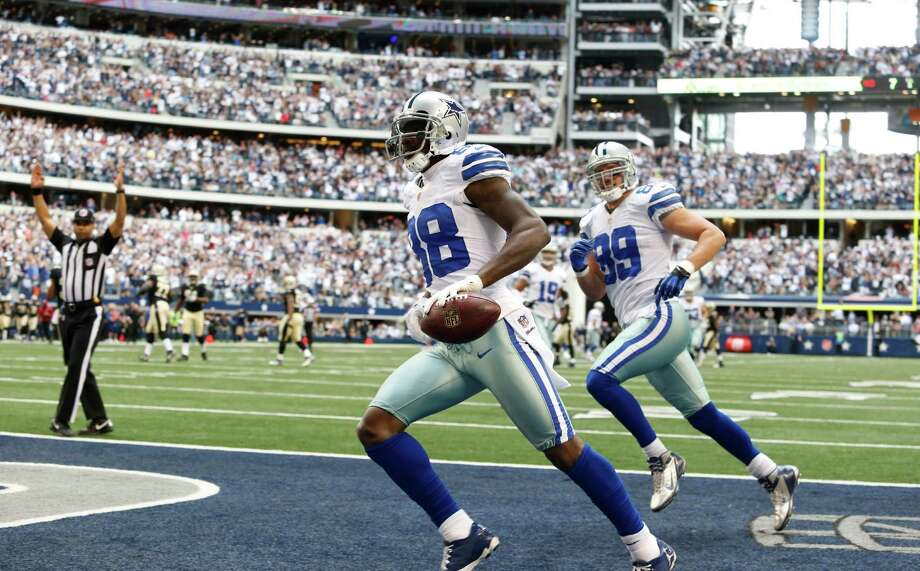 Dallas Cowboys wide receiver Dez Bryant (88) runs in a touchdown as teammate John Phillips (89) looks on during the first half of an NFL football game Sunday, Dec. 23, 2012 in Arlington, Texas. (AP Photo/Sharon Ellman) Photo: Sharon Ellman, Associated Press / AP