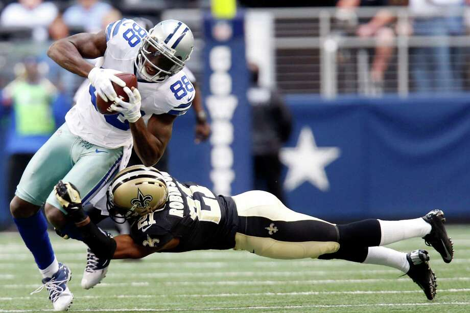 Dallas Cowboys wide receiver Dez Bryant (88) breaks away from New Orleans Saints cornerback Patrick Robinson (21) to score a touchdown during the first half of an NFL football game on Sunday, Dec. 23, 2012, in Arlington, Texas. (AP Photo/Sharon Ellman) Photo: Sharon Ellman, Associated Press / AP