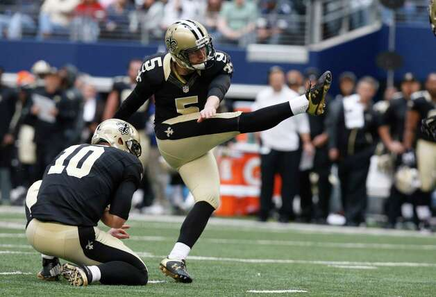 New Orleans Saints kicker Garrett Hartley (5) kicks a field goal as teammate Chase Daniel (10) holds during the first half of an NFL football game against the Dallas Cowboys  Sunday, Dec. 23, 2012 in Arlington, Texas. (AP Photo/Sharon Ellman) Photo: Sharon Ellman, Associated Press / AP