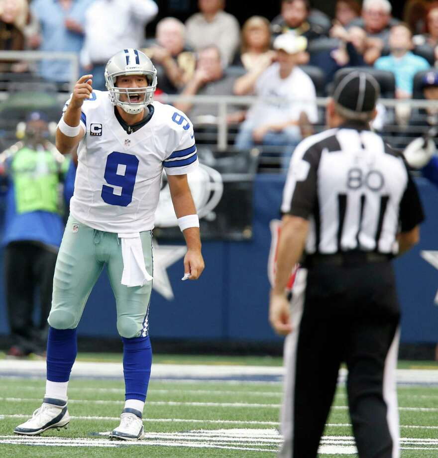 Dallas Cowboys quarterback Tony Romo (9) looks for the call from field judge Greg Gautreaux (80) during the first half of an NFL football game against the New Orleans Saints Sunday, Dec. 23, 2012 in Arlington, Texas. (AP Photo/Sharon Ellman) Photo: Sharon Ellman, Associated Press / AP