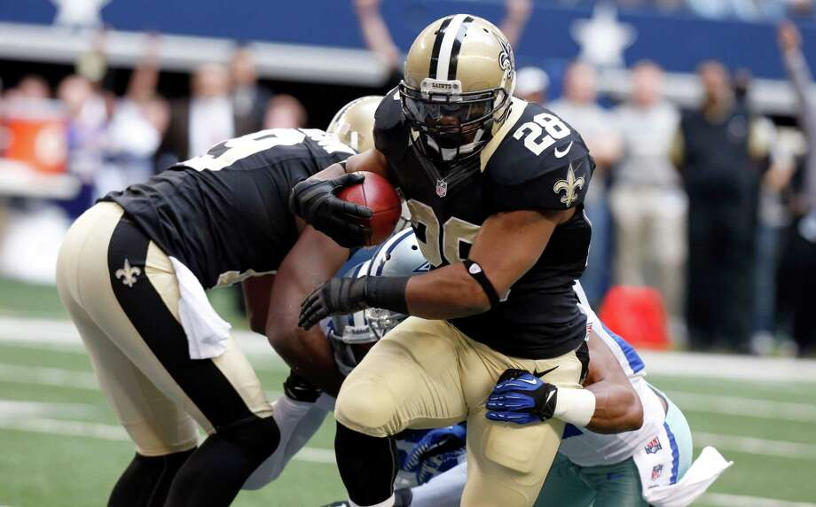 New Orleans Saints running back Mark Ingram (28) gets past Dallas Cowboys strong safety Eric Frampton to score a touchdown during the first half of an NFL football game on Sunday, Dec. 23, 2012, in Arlington, Texas. (AP Photo/Sharon Ellman) Photo: Sharon Ellman, Associated Press / AP