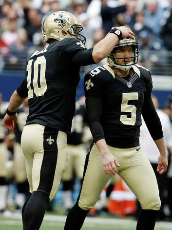 New Orleans Saints kicker Garrett Hartley (5) is congratulated on his field goal against the Dallas Cowboys by quarterback Chase Daniel (10) during the first half of an NFL football game on Sunday, Dec. 23, 2012, in Arlington, Texas. (AP Photo/Sharon Ellman) Photo: Sharon Ellman, Associated Press / AP