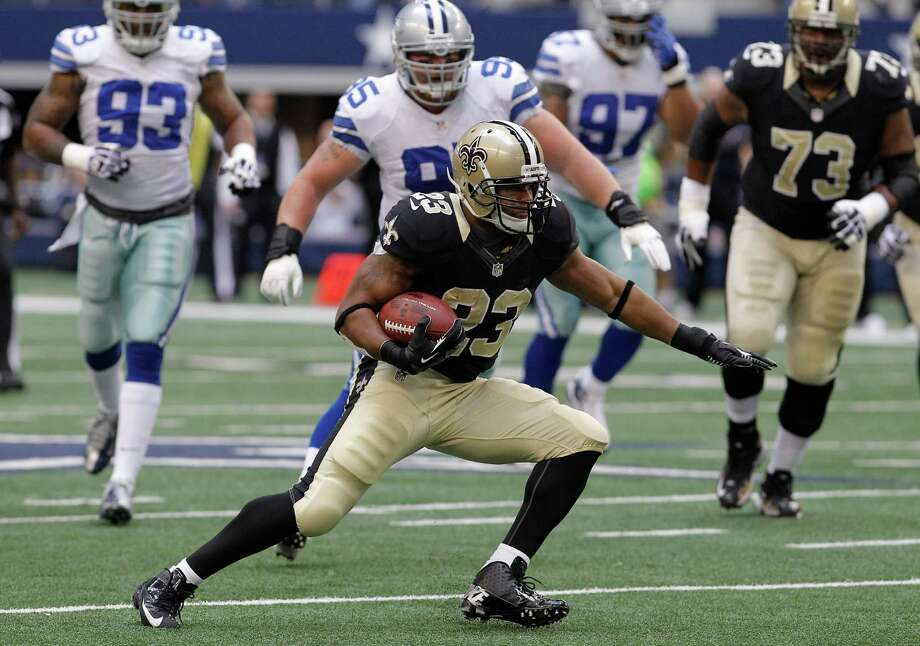 New Orleans Saints running back Pierre Thomas (23) finds open running during the first half of an NFL football game against the Dallas Cowboys  Sunday, Dec. 23, 2012 in Arlington, Texas. (AP Photo/Brandon Wade) Photo: Brandon Wade, Associated Press / AP