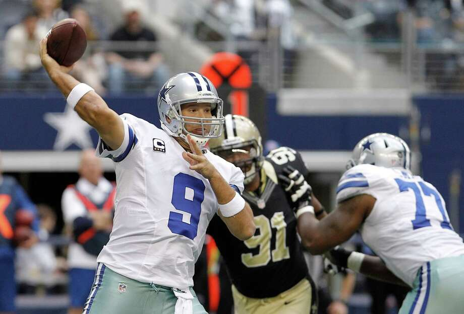 Dallas Cowboys quarterback Tony Romo (9) passes as teammate Tyron Smith (77) blocks New Orleans Saints defensive end Will Smith (91) during the first half of an NFL football game Sunday, Dec. 23, 2012 in Arlington, Texas. (AP Photo/Brandon Wade) Photo: Brandon Wade, Associated Press / AP