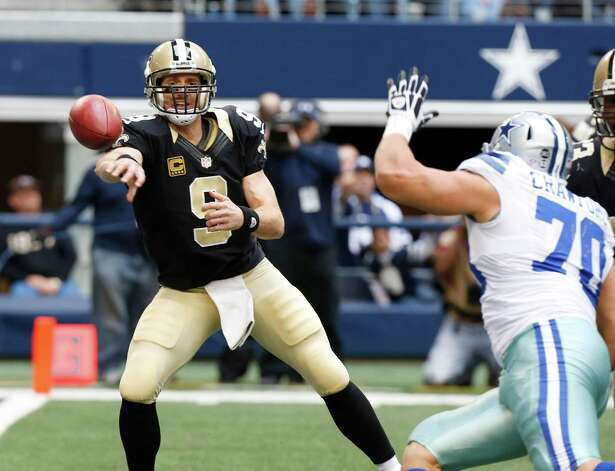 New Orleans Saints quarterback Drew Brees (9) passes as Dallas Cowboys defensive end Tyrone Crawford (70) closes in during the first half of an NFL football game against the Dallas Cowboys Sunday, Dec. 23, 2012 in Arlington, Texas. (AP Photo/Sharon Ellman) Photo: Sharon Ellman, Associated Press / AP