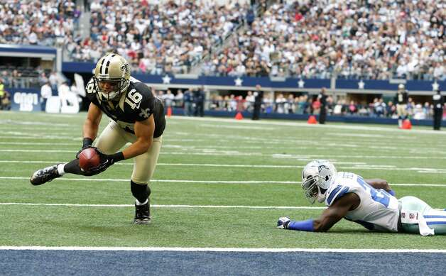 New Orleans Saints wide receiver Lance Moore (16) beats Dallas Cowboys strong safety Charlie Peprah (26) scoring a touchdown during the first half of an NFL football game against the Dallas Cowboys Sunday, Dec. 23, 2012 in Arlington, Texas. (AP Photo/Sharon Ellman) Photo: Sharon Ellman, Associated Press / AP