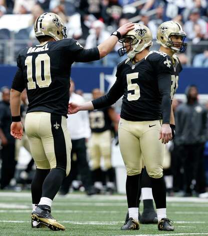 New Orleans Saints kicker Garrett Hartley (5) gets a pat from holder Chase Daniel (10) on the extra point during the first half of an NFL football game against the Dallas Cowboys  Sunday, Dec. 23, 2012 in Arlington, Texas. (AP Photo/Sharon Ellman) Photo: Sharon Ellman, Associated Press / AP