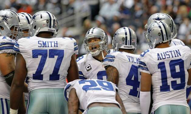 Dallas Cowboys quarterback Tony Romo, center, speaks to teammates in the huddle during the second half of an NFL football game against the New Orleans Saints  Sunday, Dec. 23, 2012 in Arlington, Texas. (AP Photo/Sharon Ellman) Photo: Sharon Ellman, Associated Press / AP