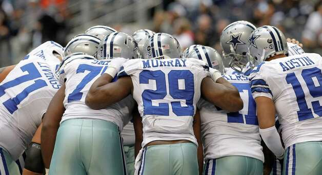 Dallas Cowboys running back DeMarco Murray (29) gets in on the huddle with teammates during the second half of an NFL football game against the New Orleans Saints  Sunday, Dec. 23, 2012 in Arlington, Texas. (AP Photo/Brandon Wade) Photo: Brandon Wade, Associated Press / AP