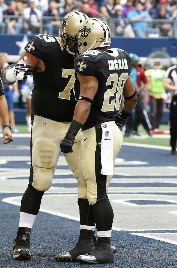 New Orleans Saints running back Mark Ingram (28) and Jahri Evans (73) celebrate a touchdown during the first half of an NFL football game Sunday, Dec. 23, 2012 in Arlington, Texas. (AP Photo/Sharon Ellman) Photo: Sharon Ellman, Associated Press / AP