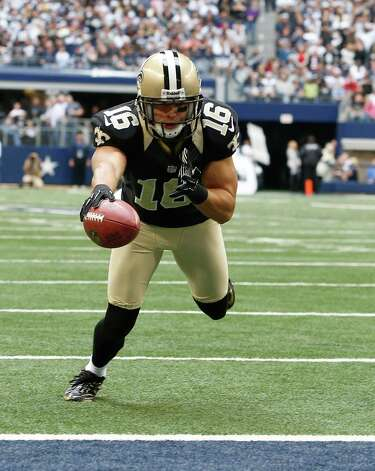New Orleans Saints wide receiver Lance Moore (16) dives in for a touchdown during the first half of an NFL football game against the Dallas Cowboys Sunday, Dec. 23, 2012 in Arlington, Texas. (AP Photo/Sharon Ellman) Photo: Sharon Ellman, Associated Press / AP