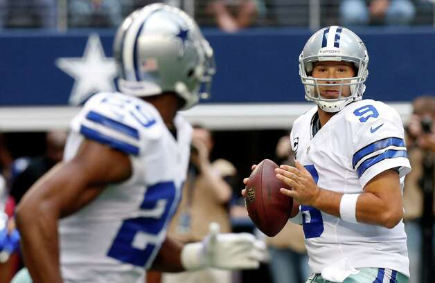 Dallas Cowboys quarterback Tony Romo (9) looks to pass the ball to running back DeMarco Murray (29) during the first half of an NFL football game against the New Orleans Saint,s Sunday, Dec. 23, 2012, in Arlington, Texas. (AP Photo/Sharon Ellman) Photo: Sharon Ellman, Associated Press / AP