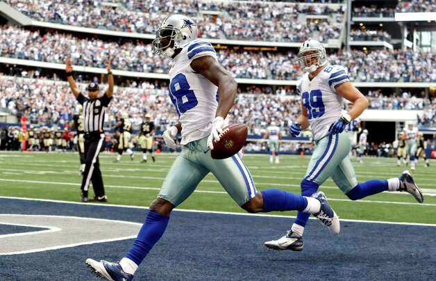 Dallas Cowboys wide receiver Dez Bryant (88) goes in for a touchdown against the New Orleans Saints as tight end John Phillips (89) follows during the first half of an NFL football game on Sunday, Dec. 23, 2012, in Arlington, Texas. (AP Photo/Sharon Ellman) Photo: Sharon Ellman, Associated Press / AP
