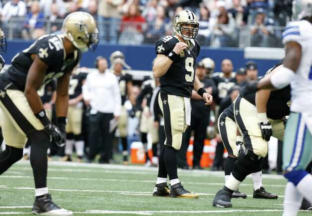 New Orleans Saints quarterback Drew Brees (9) looks to wide receiver Marques Colston (12) during the first half of an NFL football game against the Dallas Cowboys Sunday, Dec. 23, 2012 in Arlington, Texas. (AP Photo/Sharon Ellman) Photo: Sharon Ellman, Associated Press / AP