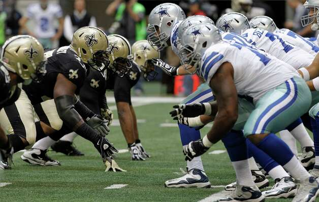 The New Orleans Saints and Dallas Cowboys line up during the second half of an NFL football game Sunday, Dec. 23, 2012 in Arlington, Texas. (AP Photo/Brandon Wade) Photo: Brandon Wade, Associated Press / AP
