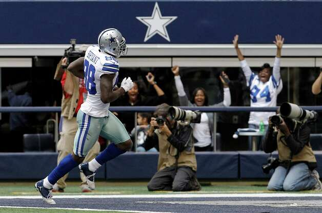 Dallas Cowboys wide receiver Dez Bryant (88) scores a touchdown against the New Orleans Saints during the first half of an NFL football game on Sunday, Dec. 23, 2012, in Arlington, Texas. (AP Photo/Brandon Wade) Photo: Brandon Wade, Associated Press / AP