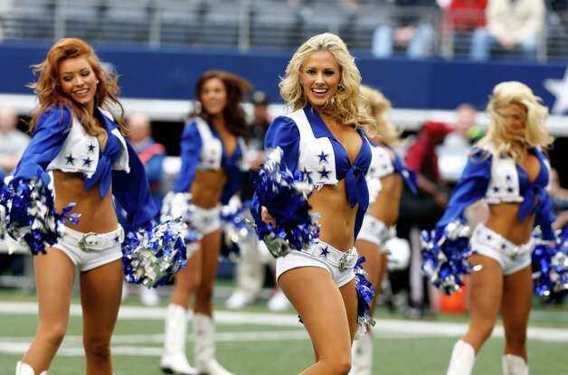 Dallas Cowboys cheerleaders dance before the NFL football game against the New Orleans Saints Sunday, Dec. 23, 2012 in Arlington, Texas. (AP Photo/Brandon Wade) Photo: Brandon Wade, Associated Press / AP