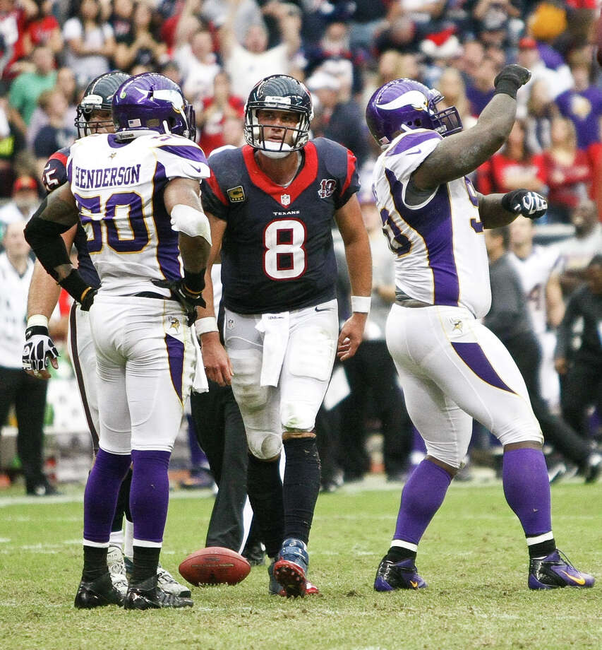 Minnesota Vikings defensive tackle Fred Evans (90)  dances after sacking Houston Texans quarterback Matt Schaub (8) during the fourth quarter of a NFL game, Sunday, Dec. 23, 2012, at Reliant Stadium  in Houston. Photo: Nick De La Torre, Houston Chronicle / © 2012  Houston Chronicle