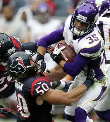 Minnesota Vikings cornerback Marcus Sherels (35) pushes off of Houston Texans linebacker Bryan Braman (50) on a punt return during the second quarter of a NFL game, Sunday, Dec. 23, 2012, at Reliant Stadium  in Houston. Photo: Nick De La Torre, Houston Chronicle / © 2012  Houston Chronicle