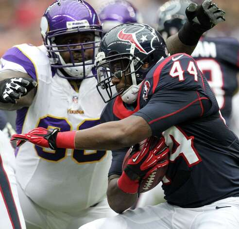 Houston Texans running back Ben Tate (44) is tackled by Minnesota Vikings defensive tackle Fred Evans (90) during the first quarter of a NFL game, Sunday, Dec. 23, 2012, at Reliant Stadium  in Houston. Photo: Nick De La Torre, Houston Chronicle / © 2012  Houston Chronicle