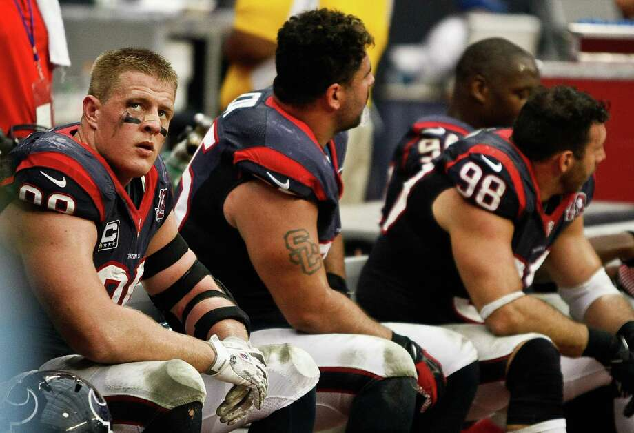 Houston Texans defensive end J.J. Watt (99) watches the Texans offense as he sits on the bench with his teammates during the fourth quarter of a NFL game against the Minnesota Vikings, Sunday, Dec. 23, 2012, at Reliant Stadium  in Houston. Photo: Nick De La Torre, Houston Chronicle / © 2012  Houston Chronicle