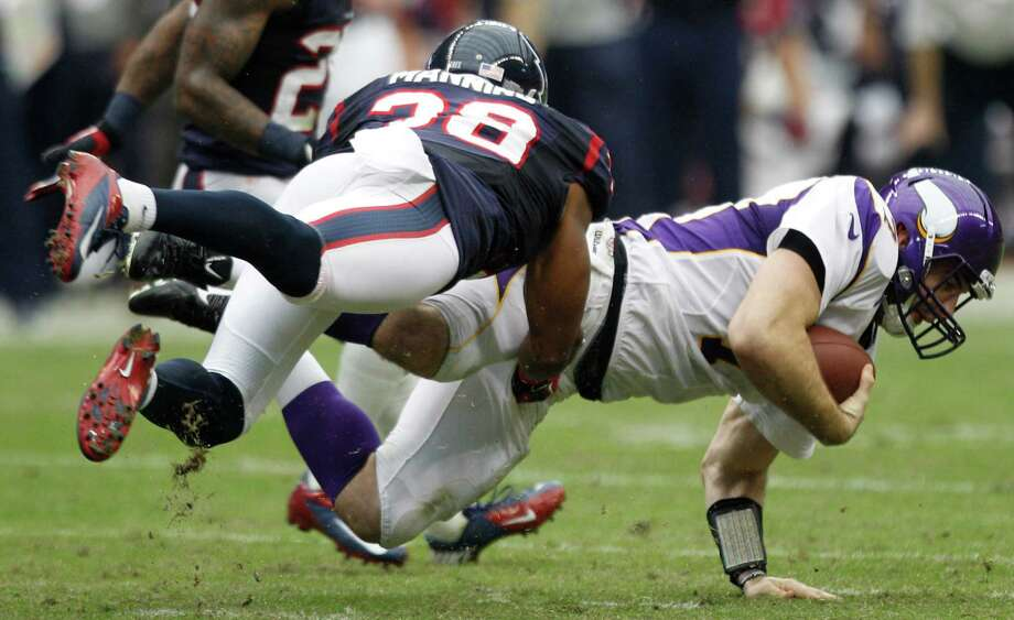 Minnesota Vikings quarterback Christian Ponder (7) is brought down by Houston Texans free safety Danieal Manning (38) during the second quarter at Reliant Stadium on Sunday, Dec. 23, 2012, in Houston. Photo: Brett Coomer, Houston Chronicle / © 2012  Houston Chronicle