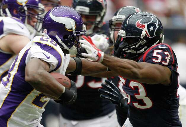 Minnesota Vikings running back Adrian Peterson (28) pushes off the facemask of Houston Texans free safety Danieal Manning (38) during the second quarter at Reliant Stadium on Sunday, Dec. 23, 2012, in Houston. Photo: Brett Coomer, Houston Chronicle / © 2012  Houston Chronicle