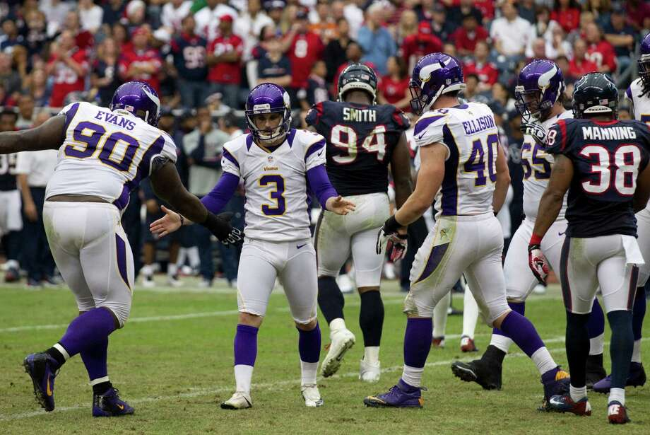 Minnesota Vikings kicker Blair Walsh (3) celebrates with defensive tackle Fred Evans (90) after kicking a field goal during the second quarter at Reliant Stadium on Sunday, Dec. 23, 2012, in Houston. Photo: Brett Coomer, Houston Chronicle / © 2012  Houston Chronicle