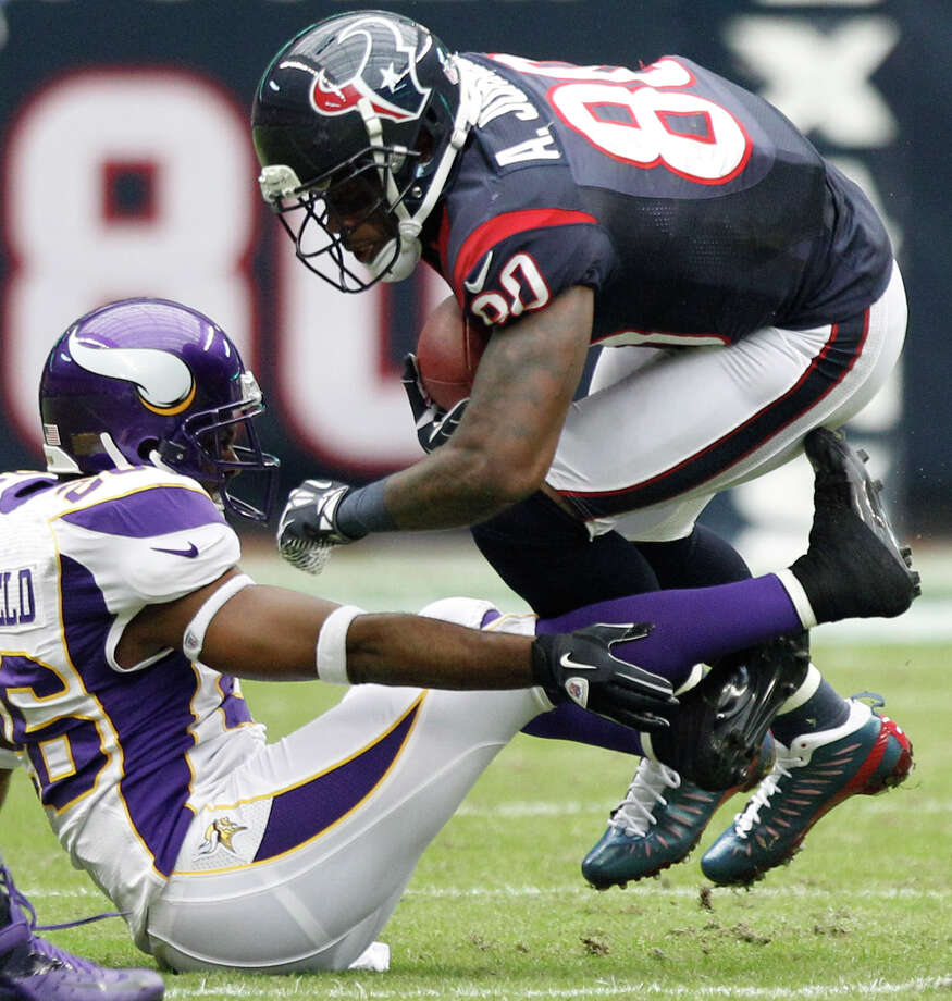 Houston Texans wide receiver Andre Johnson (80) is tripped up by Minnesota Vikings cornerback Antoine Winfield (26) during the first quarter at Reliant Stadium on Sunday, Dec. 23, 2012, in Houston. Photo: Brett Coomer, Houston Chronicle / © 2012  Houston Chronicle