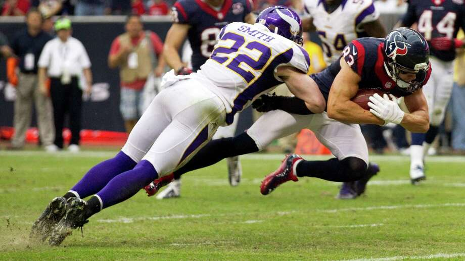 Houston Texans wide receiver Kevin Walter (83) is stopped at the one by Minnesota Vikings free safety Harrison Smith (22) during the third quarter at Reliant Stadium on Sunday, Dec. 23, 2012, in Houston. Photo: Brett Coomer, Houston Chronicle / © 2012  Houston Chronicle
