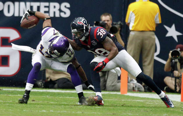Houston Texans free safety Danieal Manning (38) tackles Minnesota Vikings wide receiver Jarius Wright (17) near the goal line, and is called for a horse collar penalty, during the fourth quarter at Reliant Stadium on Sunday, Dec. 23, 2012, in Houston. Photo: Brett Coomer, Houston Chronicle / © 2012  Houston Chronicle