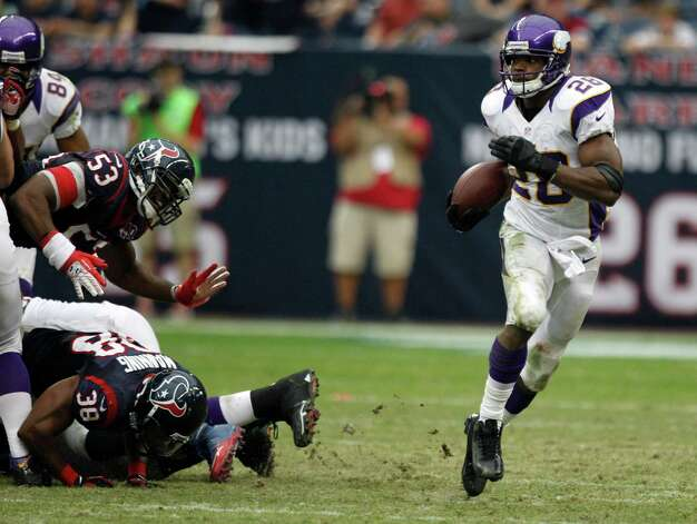 Minnesota Vikings running back Adrian Peterson (28) breaks away from Houston Texans inside linebacker Bradie James (53) and free safety Danieal Manning (38) during the third quarter at Reliant Stadium on Sunday, Dec. 23, 2012, in Houston. Photo: Brett Coomer, Houston Chronicle / © 2012  Houston Chronicle