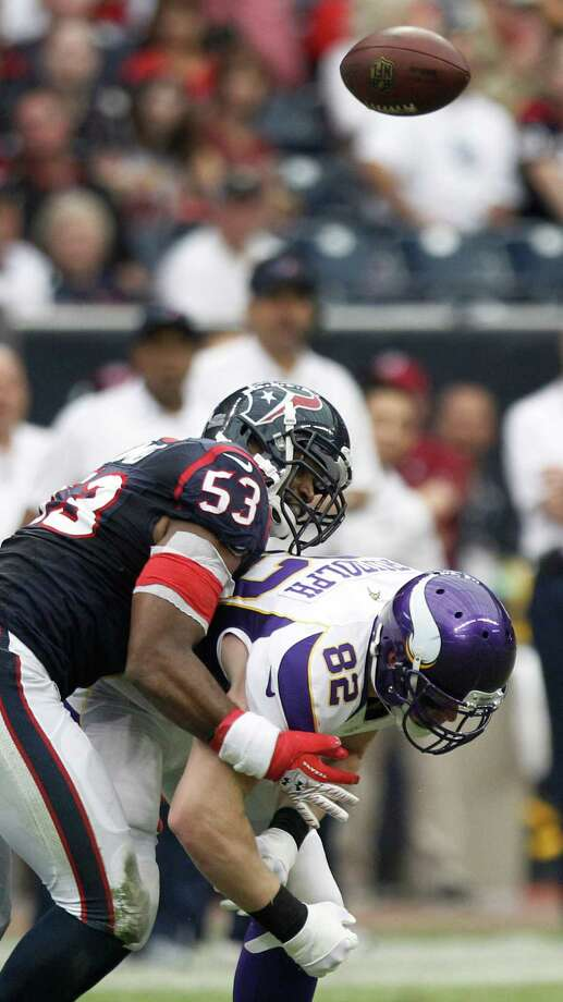 Houston Texans inside linebacker Bradie James (53) breaks up a pass intended for Minnesota Vikings tight end Kyle Rudolph (82) during the third quarter at Reliant Stadium on Sunday, Dec. 23, 2012, in Houston. Photo: Brett Coomer, Houston Chronicle / © 2012  Houston Chronicle