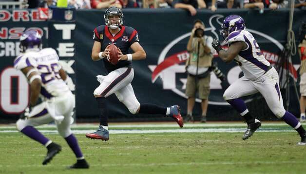 Houston Texans quarterback Matt Schaub (8) is chased out of the pocket by Minnesota Vikings defensive end Christian Ballard (99) during the third quarter at Reliant Stadium on Sunday, Dec. 23, 2012, in Houston. Photo: Brett Coomer, Houston Chronicle / © 2012  Houston Chronicle