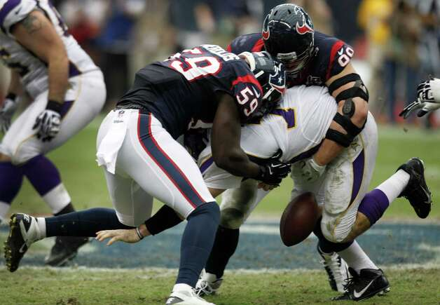 Houston Texans outside linebacker Whitney Mercilus (59) and defensive end J.J. Watt (99) force a fumble as they sack Minnesota Vikings quarterback Christian Ponder (7) during the third quarter at Reliant Stadium on Sunday, Dec. 23, 2012, in Houston. Photo: Brett Coomer, Houston Chronicle / © 2012  Houston Chronicle