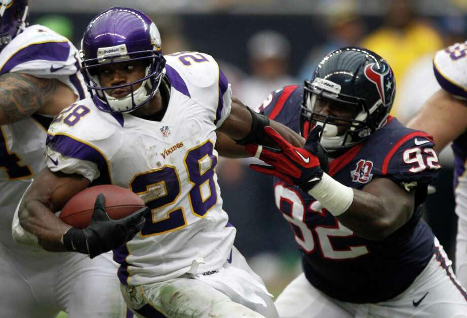 Minnesota Vikings running back Adrian Peterson (28) breaks away from Houston Texans nose tackle Earl Mitchell (92) during the third quarter at Reliant Stadium on Sunday, Dec. 23, 2012, in Houston. Photo: Brett Coomer, Houston Chronicle / © 2012  Houston Chronicle
