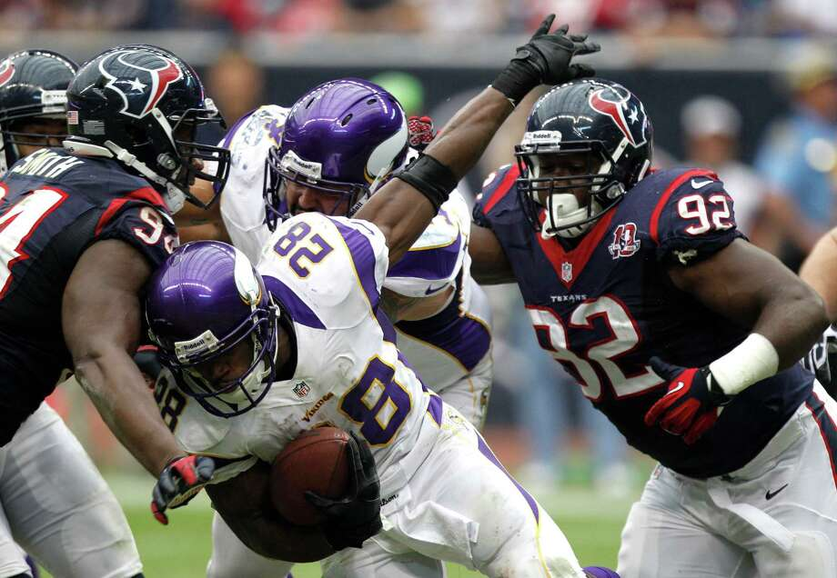 Minnesota Vikings running back Adrian Peterson (28) runs the ball between Houston Texans defensive end Antonio Smith (94) and nose tackle Earl Mitchell (92) during the third quarter at Reliant Stadium on Sunday, Dec. 23, 2012, in Houston. Photo: Brett Coomer, Houston Chronicle / © 2012  Houston Chronicle