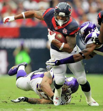 Houston Texans running back Arian Foster (23) gets past Minnesota Vikings defensive tackle Kevin Williams (93) during the first quarter of an NFL football game at Reliant Stadium, Sunday, Dec. 23, 2012, in Houston. Photo: Karen Warren, Houston Chronicle / © 2012 Houston Chronicle