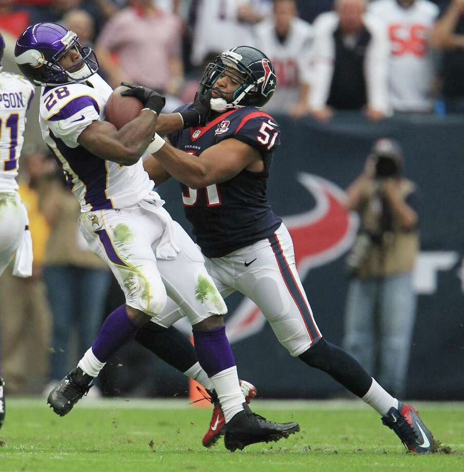 Minnesota Vikings running back Adrian Peterson (28) is brought down by Houston Texans inside linebacker Darryl Sharpton (51) during the first quarter of an NFL football game at Reliant Stadium, Sunday, Dec. 23, 2012, in Houston. Photo: Karen Warren, Houston Chronicle / © 2012 Houston Chronicle