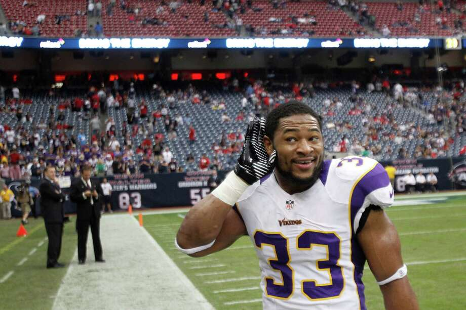 Minnesota Vikings strong safety Jamarca Sanford (33) puts his hand to his ear during the fourth quarter of the Vikings win over the Houston Texans at Reliant Stadium on Sunday, Dec. 23, 2012, in Houston. Photo: Brett Coomer, Houston Chronicle / © 2012  Houston Chronicle